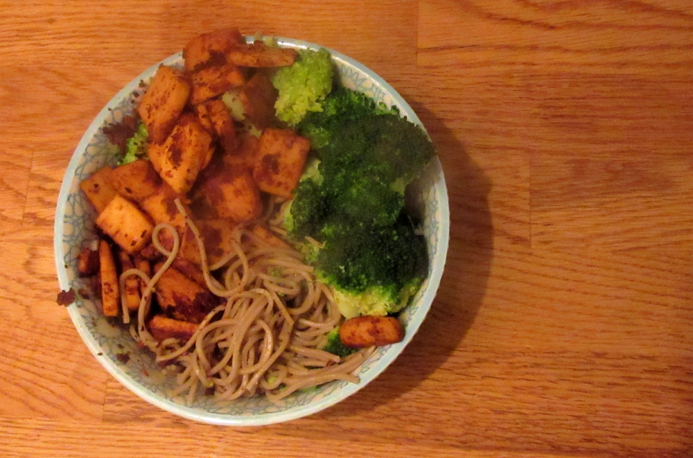 Noodle bowl with spicy peanut tofu and broccoli top shot.2