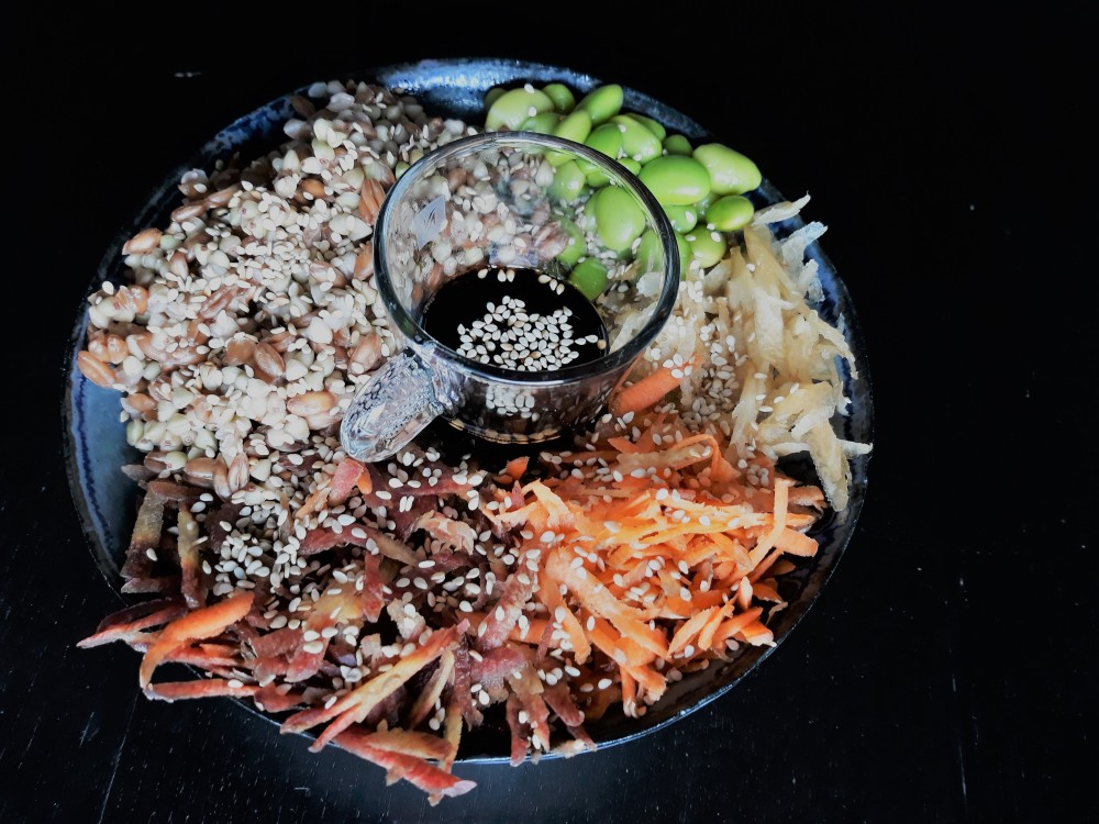 Rainbow carrot buddha bowl spelt buckwheat edamame before dressing